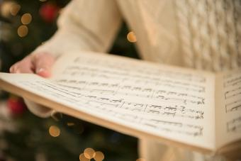 holding sheet music