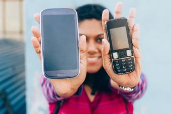 woman holding two mobile phones