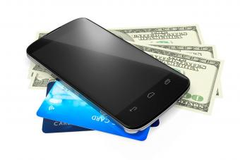 Mobile Phone On Us Paper Currency And Credit Cards