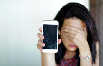 Woman Holding Broken Smart Phone