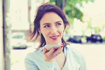 Woman using Siri function on iPhone