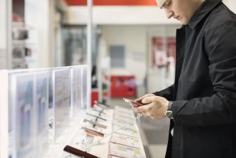 Man shopping for a smart phone at a store