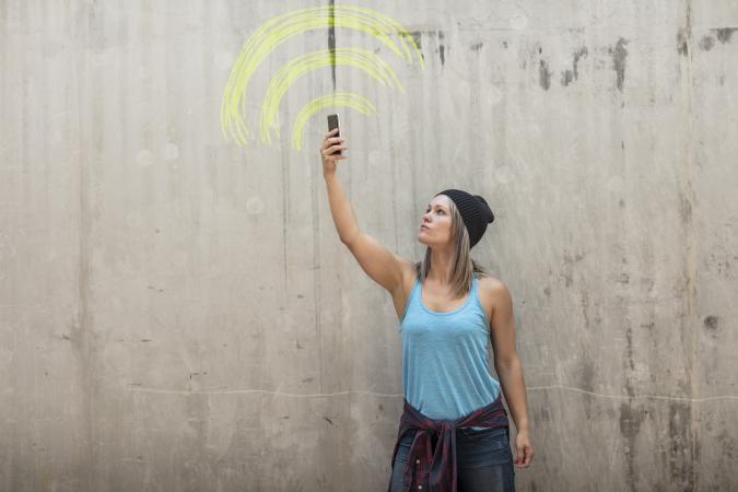 Woman looking for better phone signal