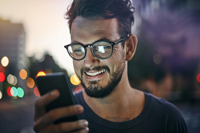 man reading text message