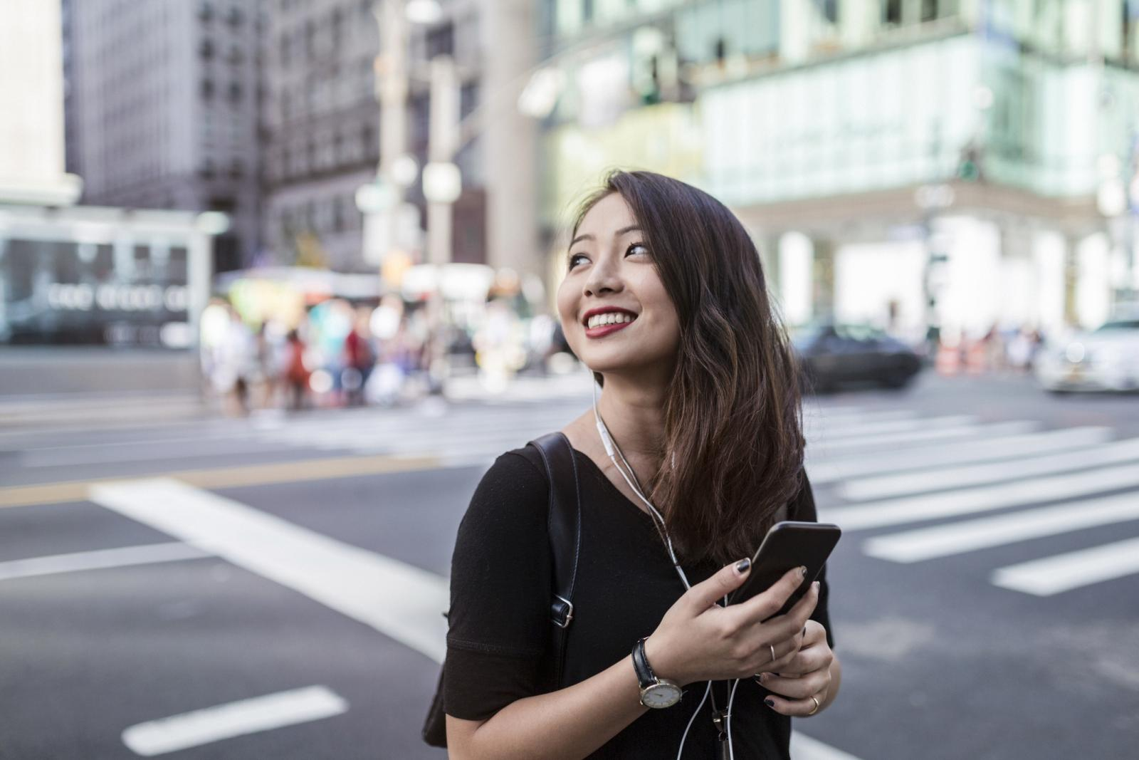 Young woman with cellphone on the street