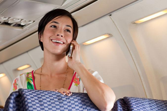 Woman on cellphone on airplane