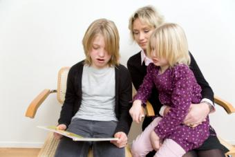Mother and kids reading book