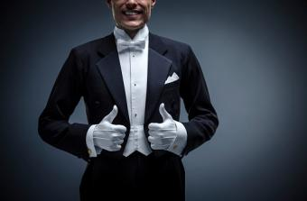 man in formal tux with gloves