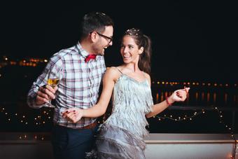 man and woman in festive attire