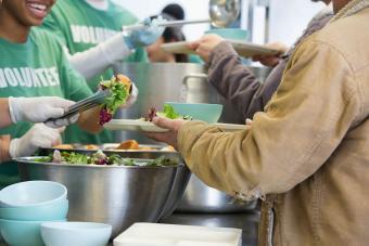 Volunteers serving food in soup kitchen