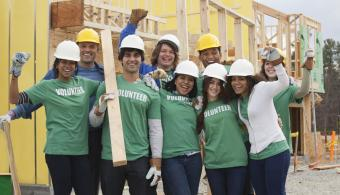 Volunteers cheering successful home building