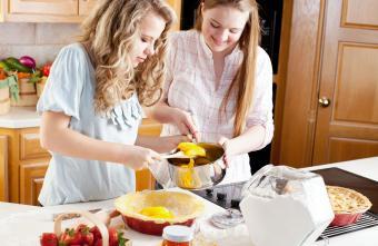 Teenage Girl Friends Making Homemade Fruit Pies