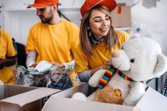 Volunteer accepting stuffed animal donation