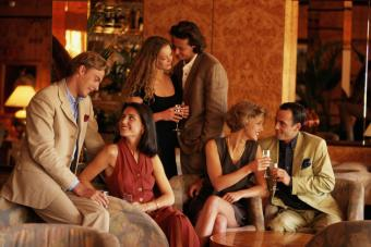 Three couples at cocktail party