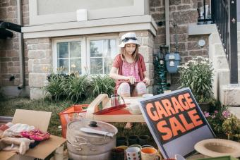 Young girl holding a garage sale for charity