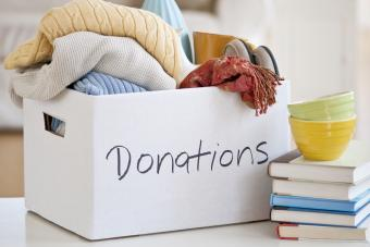 Bowls, books, and donation box filled with blankets