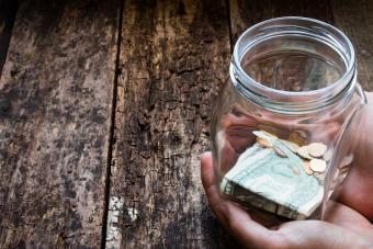 Man holding donation jar with money