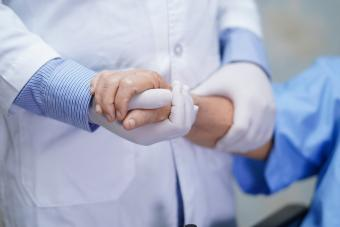 Doctor holding touching hands
