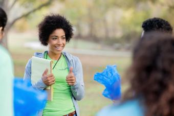 Young woman organizes community cleanup volunteers