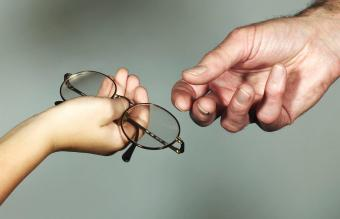 Child donating eyeglasses