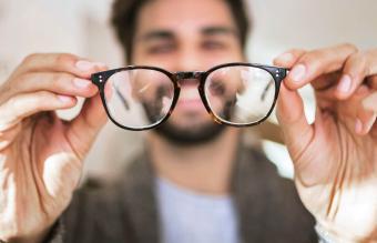 Man examining eyeglasses