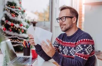 Man opening Christmas letter