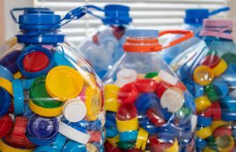Bottles full of colorful plastic bottle caps