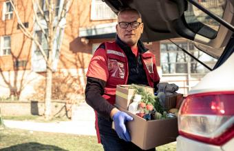 Man unloading groceries to donate