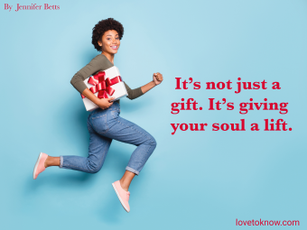 girl holding a gift box and dream jumping and a quote about giving