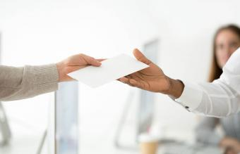handing another person an envelope