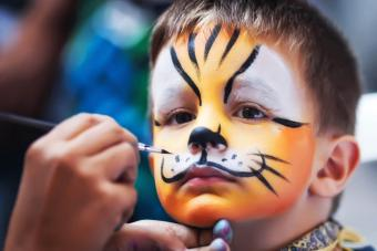 boy while being masked as tiger