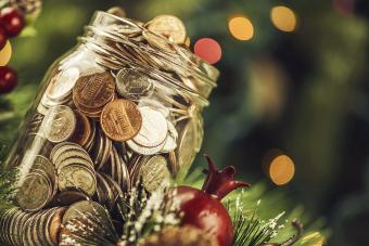 Christmas charity donation jar filled with American currency