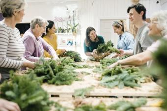 Group of people are taking part in a wreath making workshop
