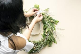 Woman decorates advent wreath with her hands
