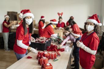 Women volunteering by preparation of Christmas presents
