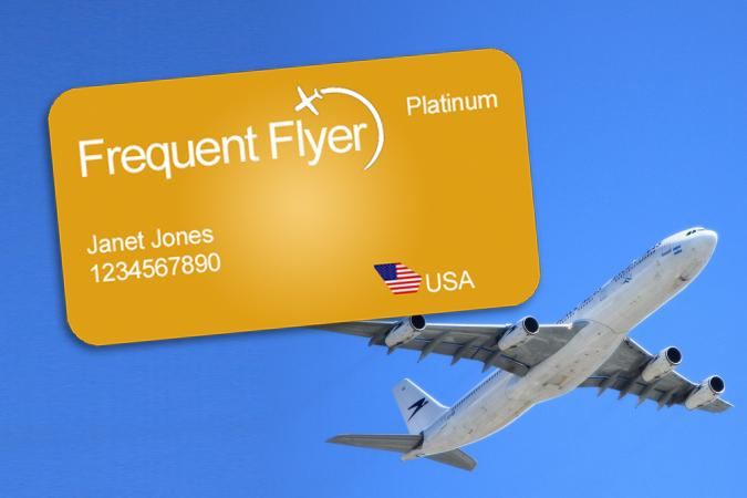 frequent flyer card and airplane