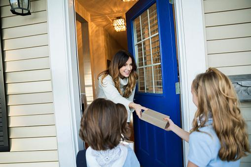Girls selling door to door