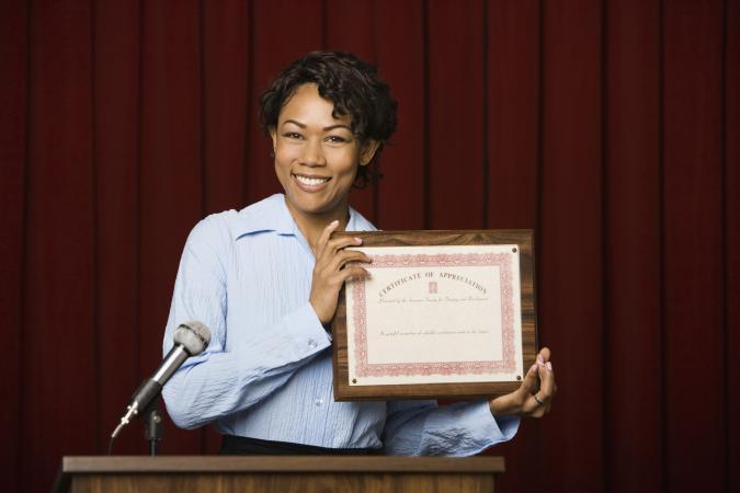 woman receiving award