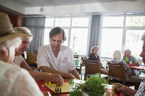 volunteer doing games in nursing home