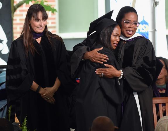 Sithokomele P. Mabaso hugging Oprah Winfrey