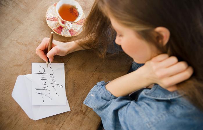 Woman writing greeting card