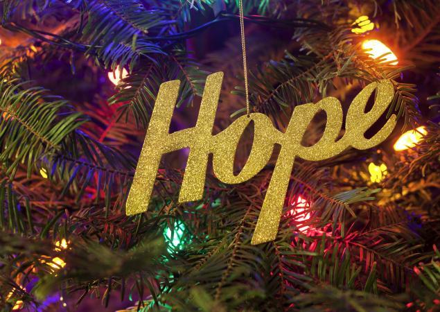 Hope Christmas ornament hanging on a Christmas tree with Christmas lights