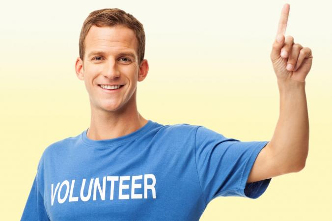 Man raising hand to volunteer
