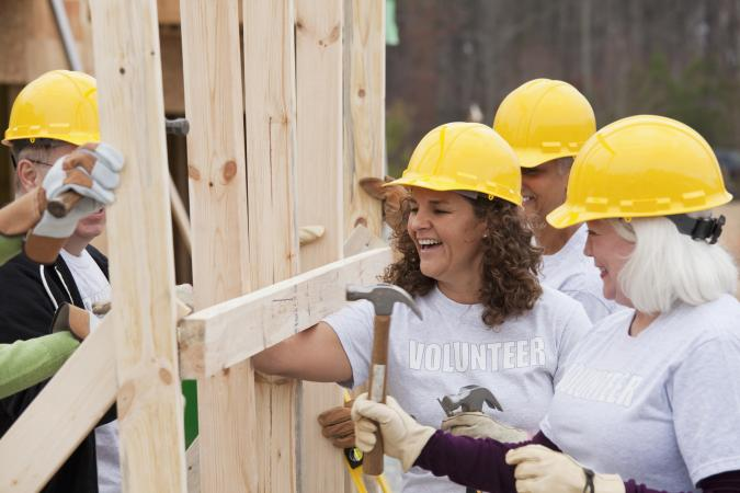 Volunteers building a house