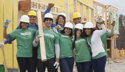 Volunteers cheering successful home building