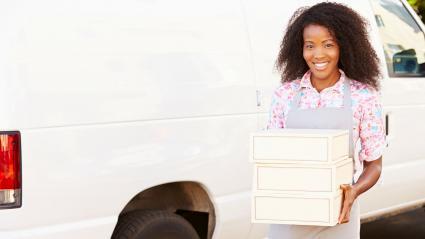 Baker Unloading Pie Boxes From Van