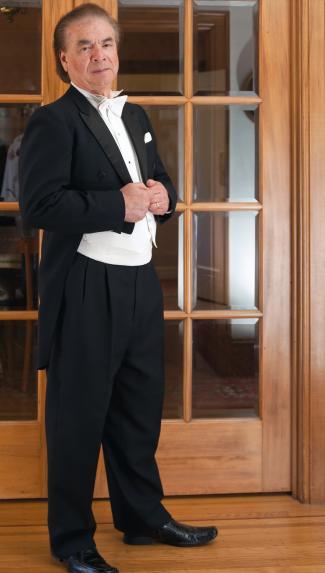 Older man dressed in white tie tuxedo