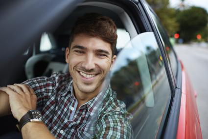 Man driving car happy to volunteer