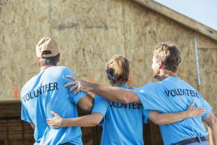 Volunteers building a house