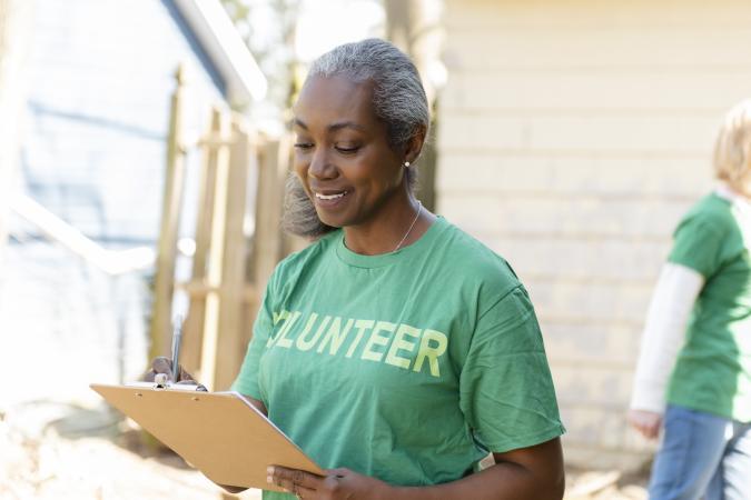 Woman volunteer holding a clipboard
